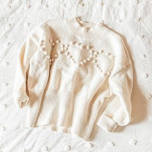 chicwish cream heart pom cozy sweater